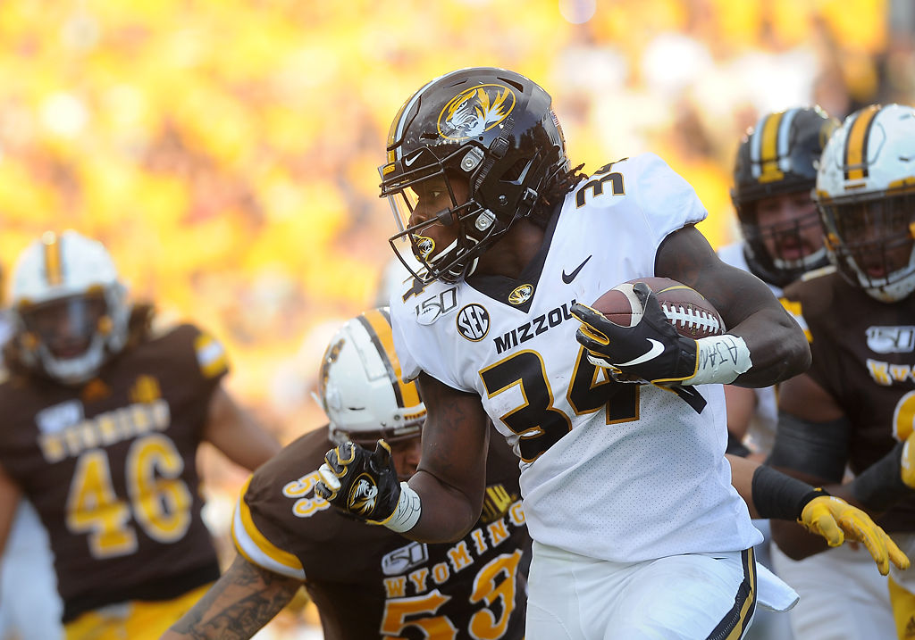 Larry Rountree III braces for a tackle