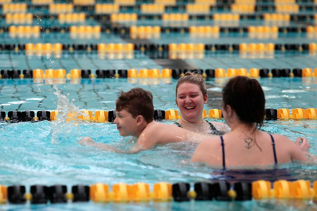 Harrison Wright swims along side of Megan Hakenwerth and Katelyn Foley