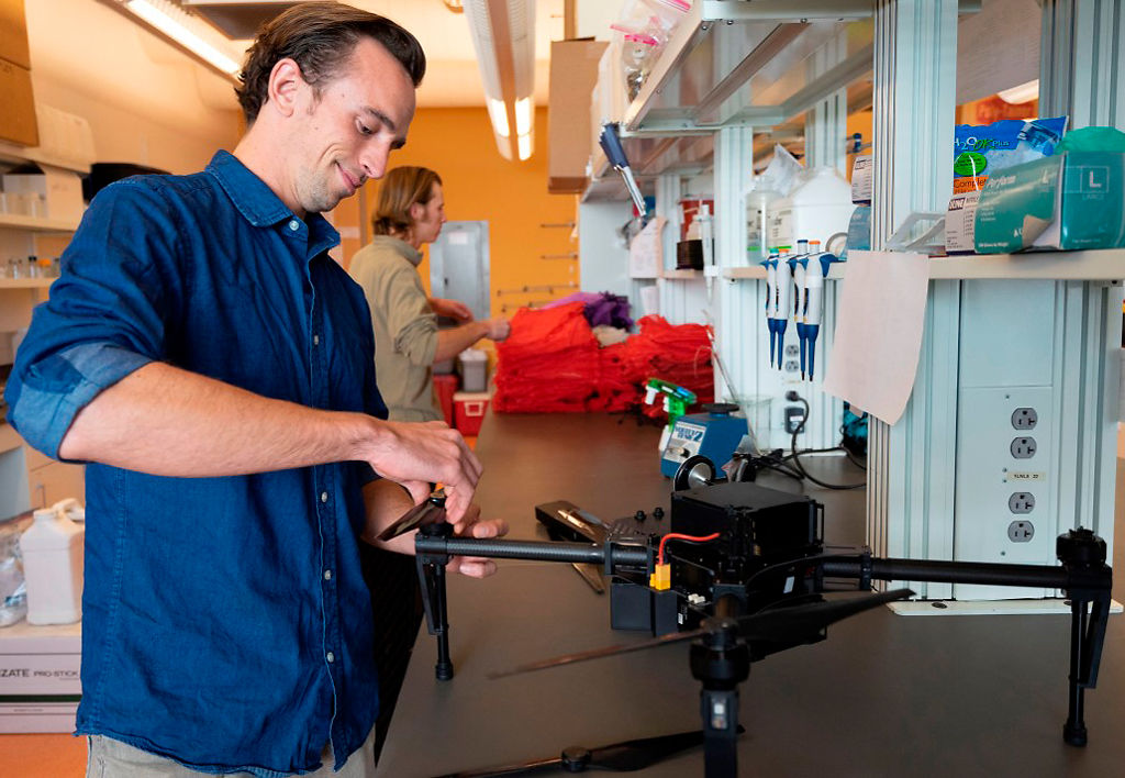 David Iseman sets up a drone equipped with auto sensing camera