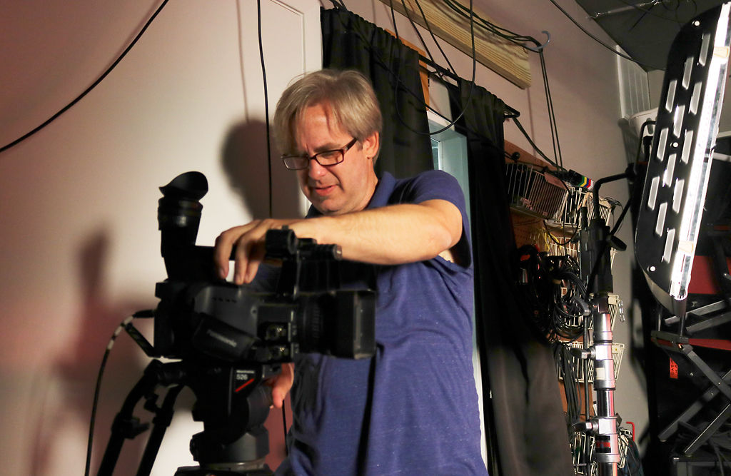 Sean Brown, managing director of CAT, sets up a video camera in the CAT studio