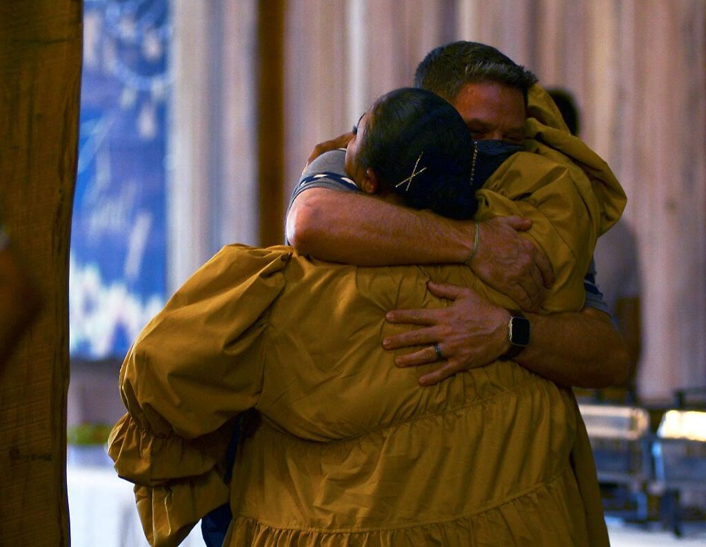 Tyus Monroe hugs Todd Maher