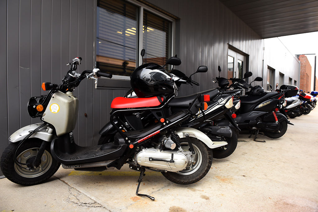 Scooters line the side of Mizzou's Athletic Training Complex building