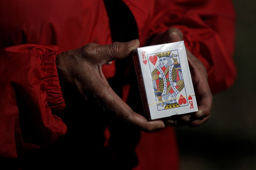 Delois Yocum, 68, shows off a pack of cards