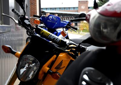 A scooter customized with a Mizzou Tiger sticker