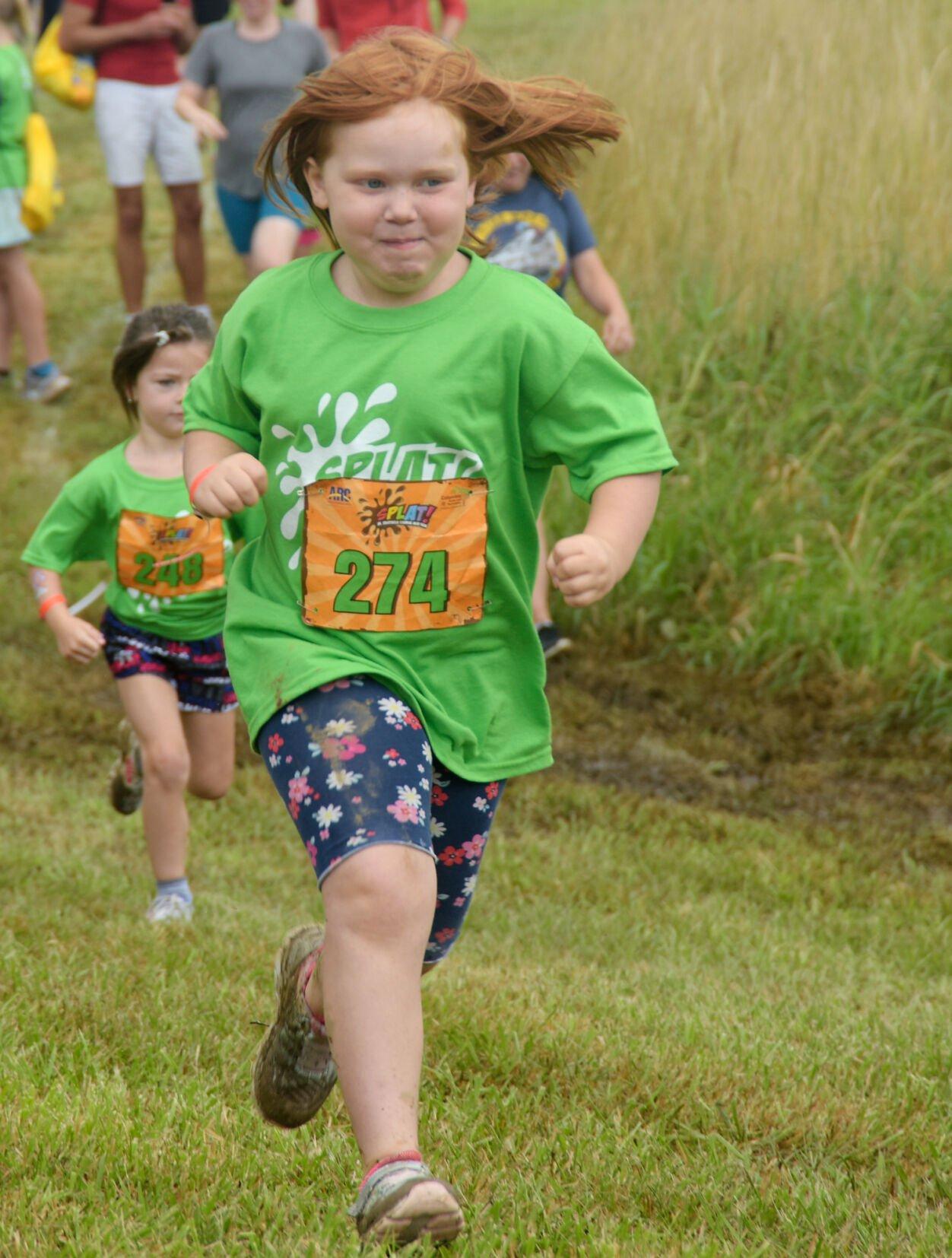Julia Rowley runs toward the first obstacle