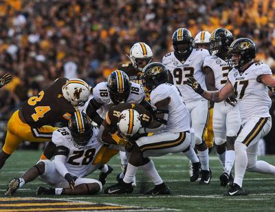 Joshua Bledsoe and Tyree Gillespie, and defensive lineman Jatorian Hansford tackle Wyoming wide receiver Raghib Ismail Jr. (copy)