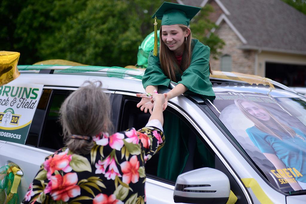 Rock Bridge High School math teacher Janet Thompson hands out candy