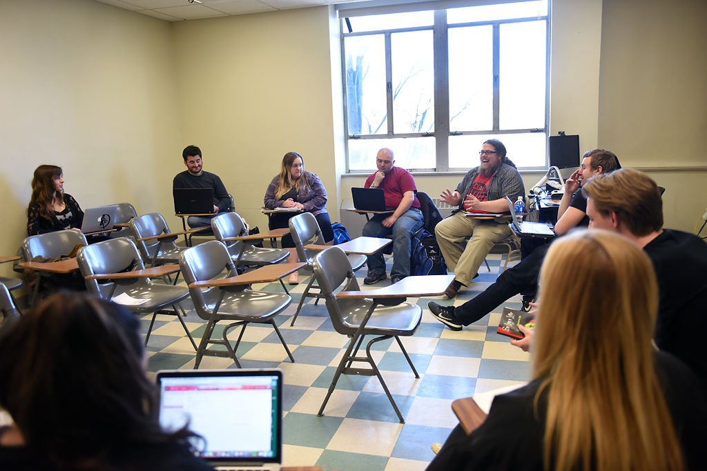 Graduate student Eric Scott leads his creative writing class