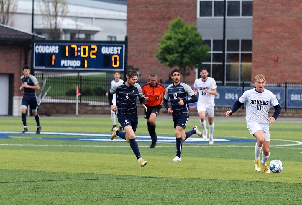 Nathan Durdle runs with the ball