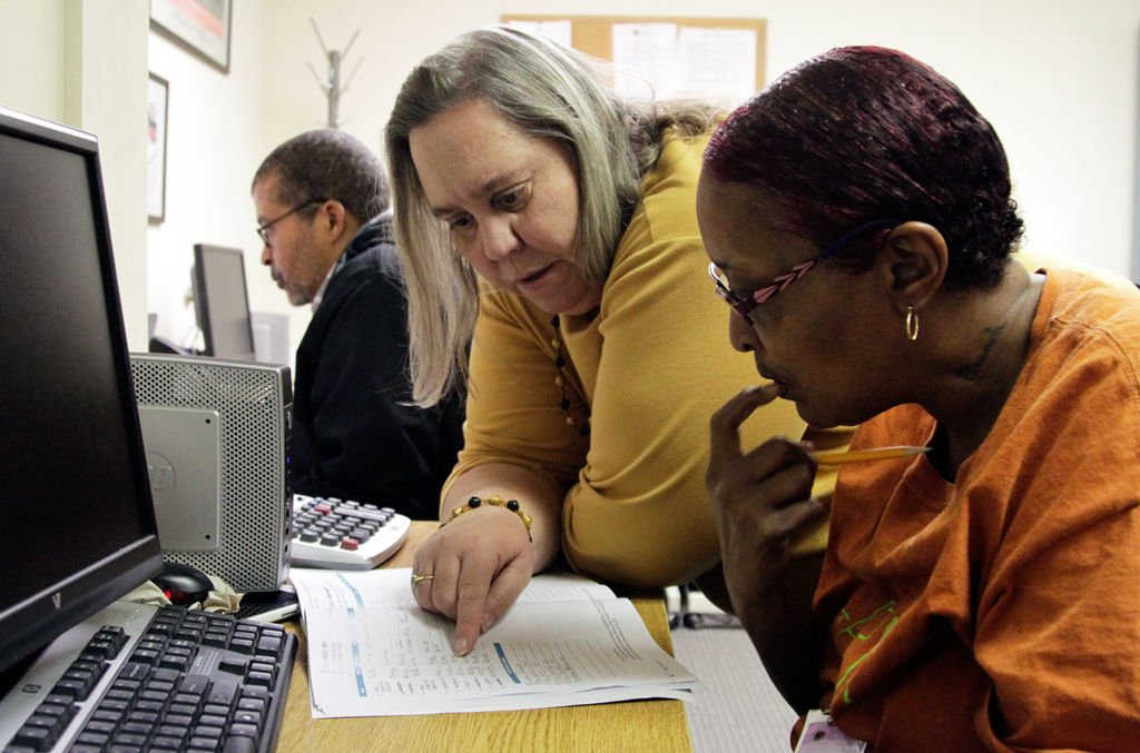 Tania Cook helps Jacqueline Rogers learn alphabetical filing