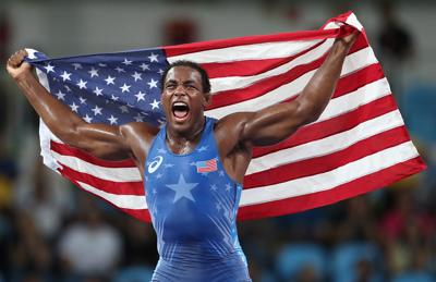 J'Den Cox celebrates at the Olympics