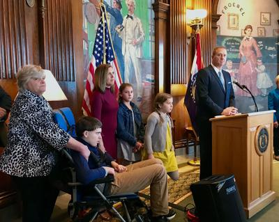 Eric Schmitt addresses the media at a news conference at the Missouri Capitol