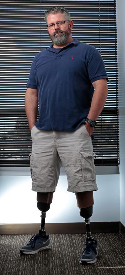 Matt Darrough stands in his office