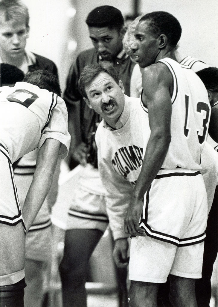 Coach Bob Burchard directs his basketball team (copy)