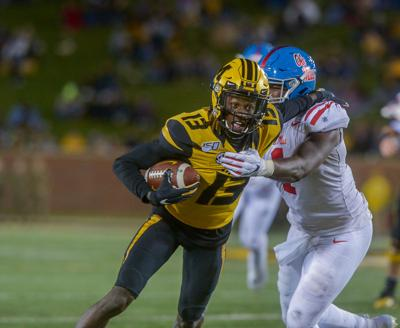 Missouri wide receiver Kam Scott runs with the ball