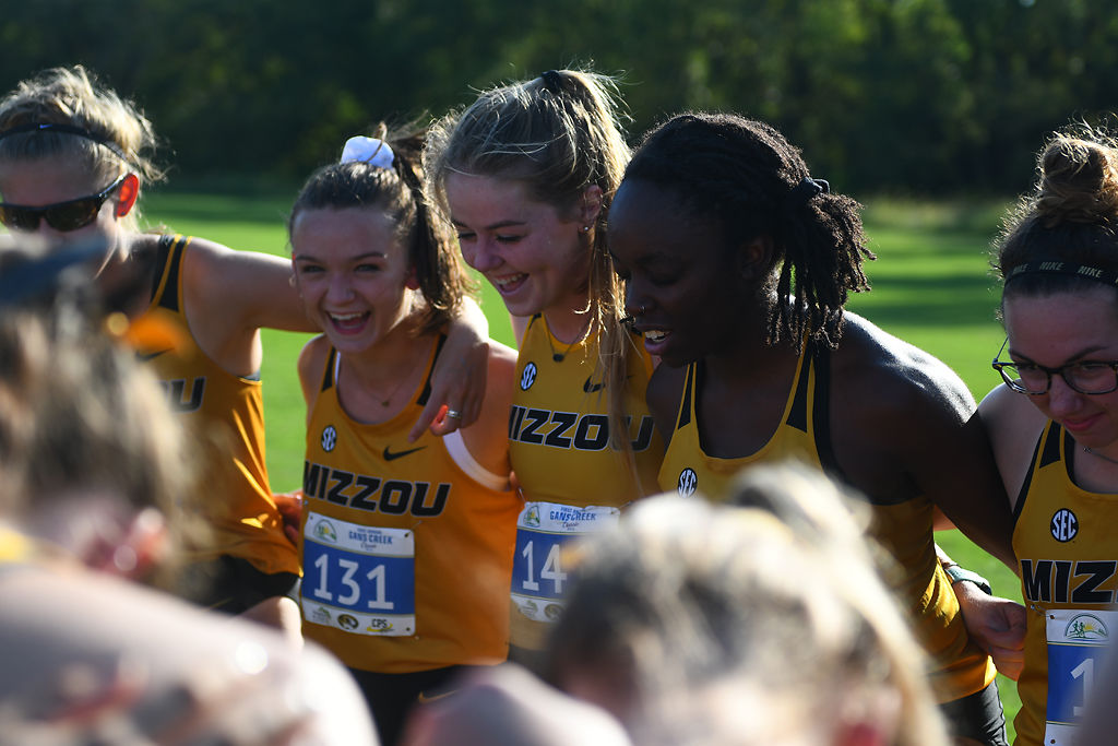 Faramola Shonekan, second from right, gives her team a pep talk before the start of the Mizzou Cross Country Challenge on Friday