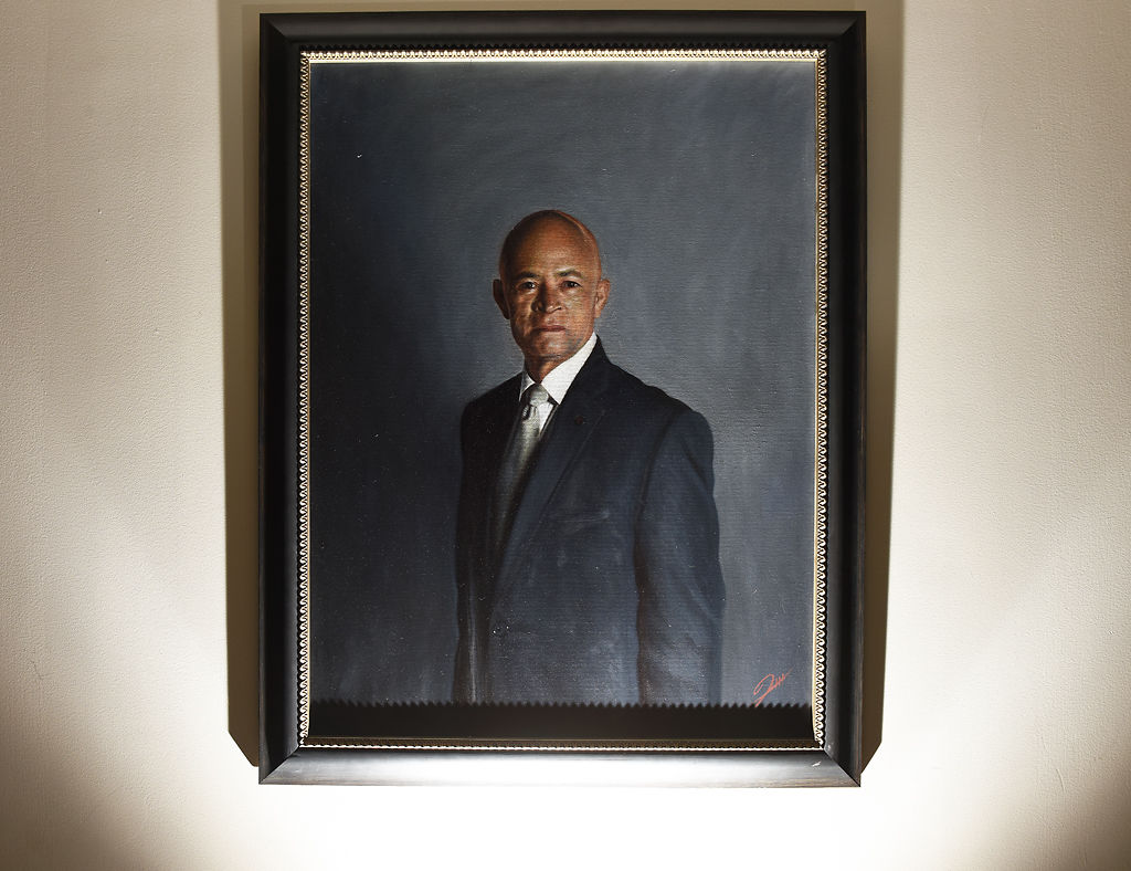 An oil painting of Interim President Michael Middleton hangs on the wall