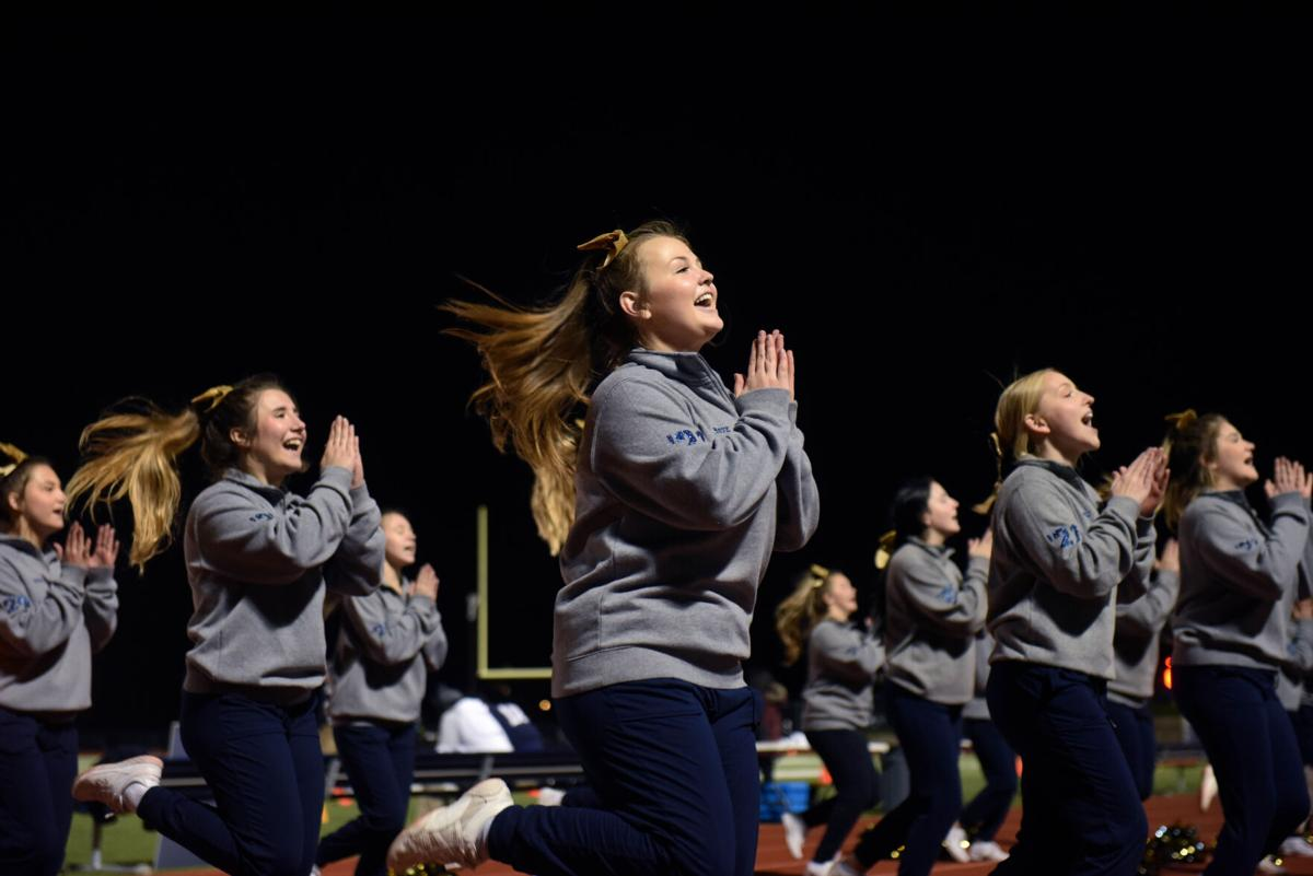 The Helias cheer team performs their fight song during halftime