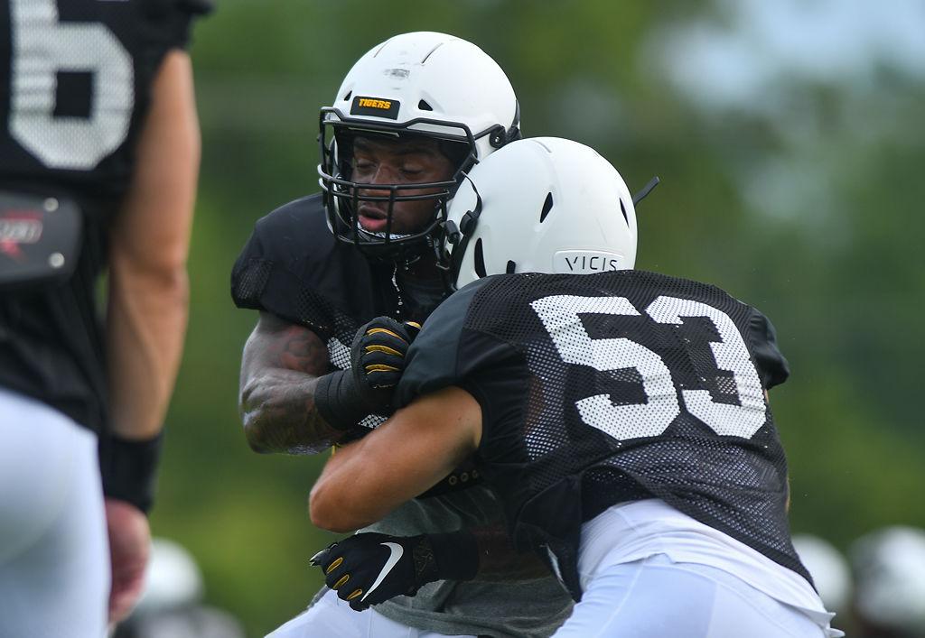 Linebacker Aubrey Miller, Jr. runs a drill with fellow linebacker Joe Hoy at the practice field