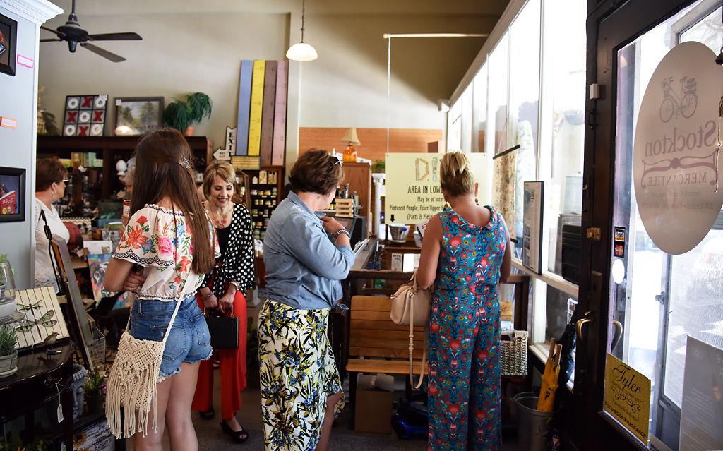 Customers walk around Stockton Mercantile