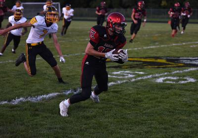 Southern Boone County High School's Tate John runs with the football