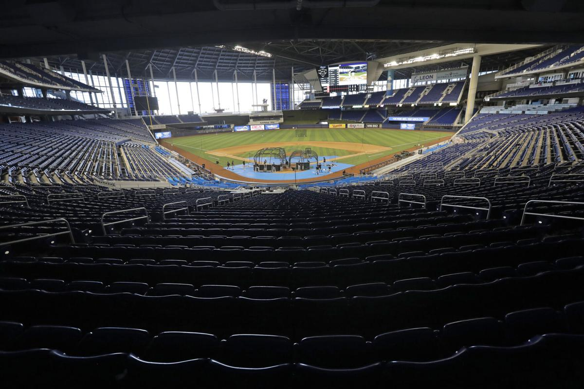 Marlins end isolation in Philly and leave for Baltimore