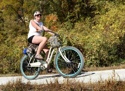 Tracy McClard pedals into the approach of the North Jefferson City Trailhead