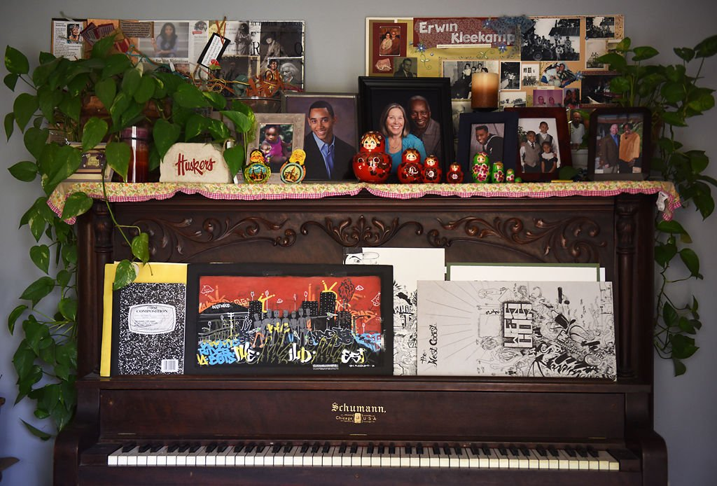 Photos sit on a piano