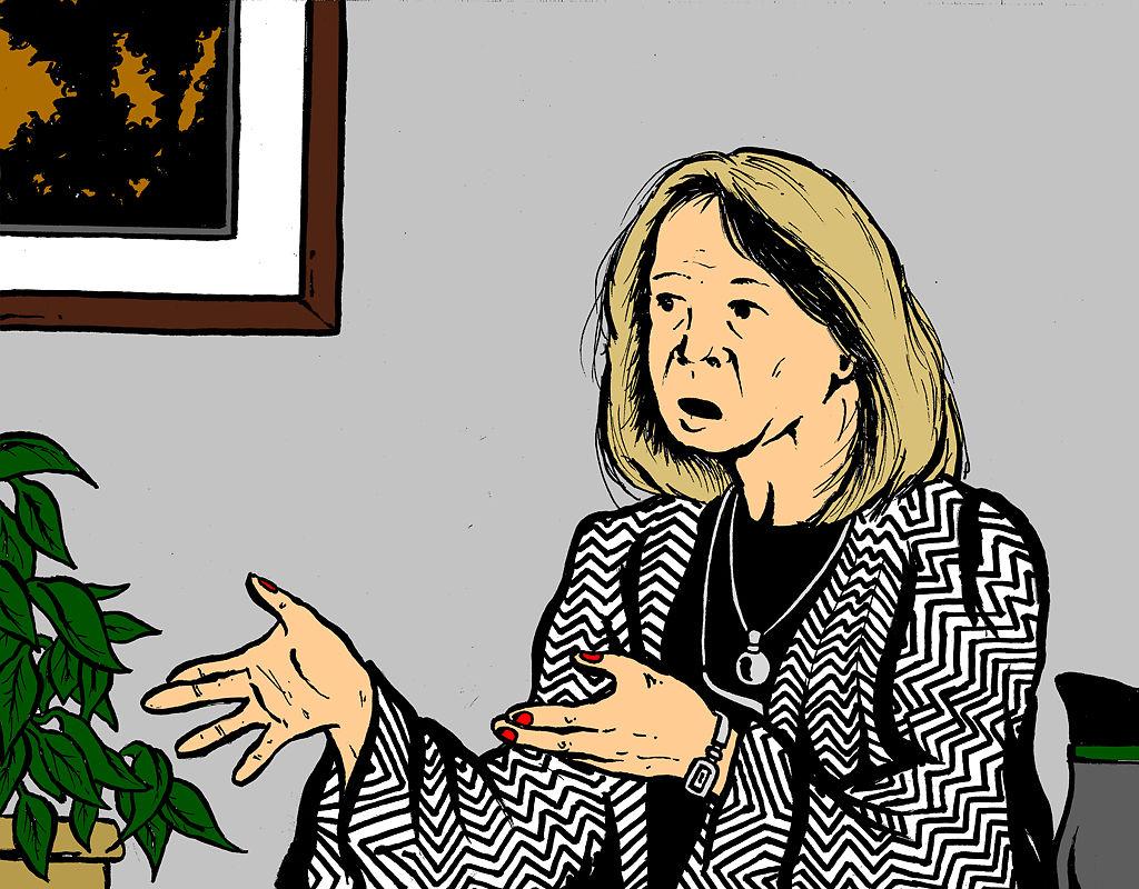 Karen Miller speaks in her office