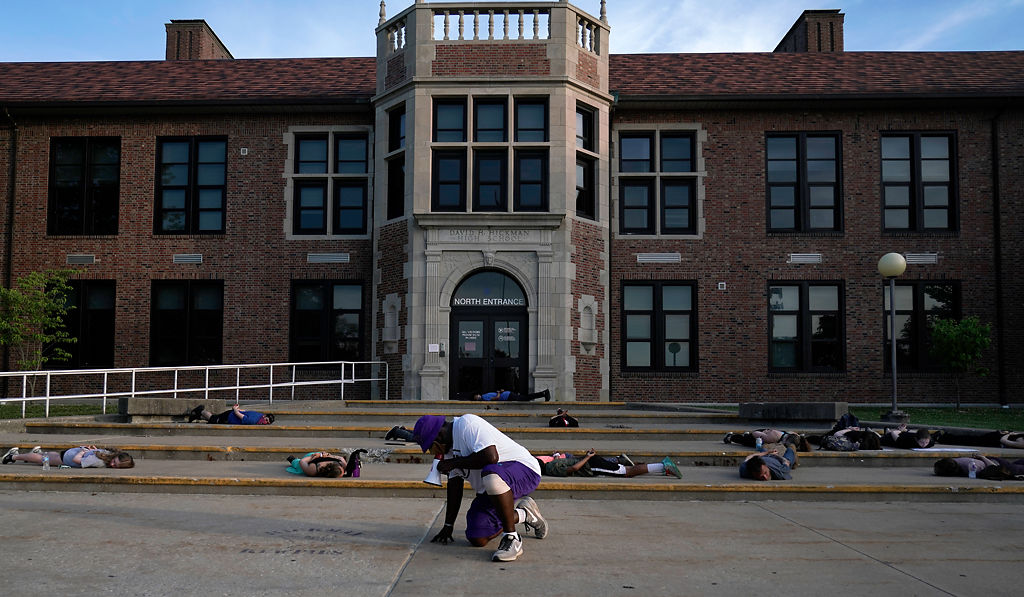 Sterling Brown and other protestors lie down in front of Hickman High School for eight minutes and 46 seconds