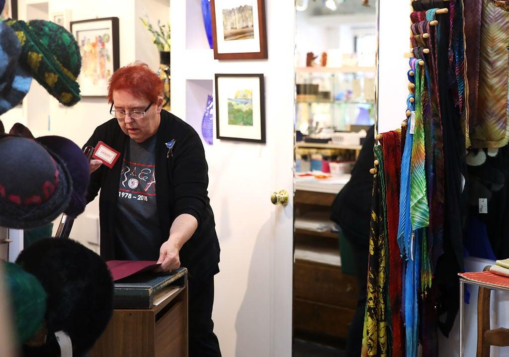 Sandy Litecky, one of the original founders in Bluestem Missouri crafts, cuts decorative paper