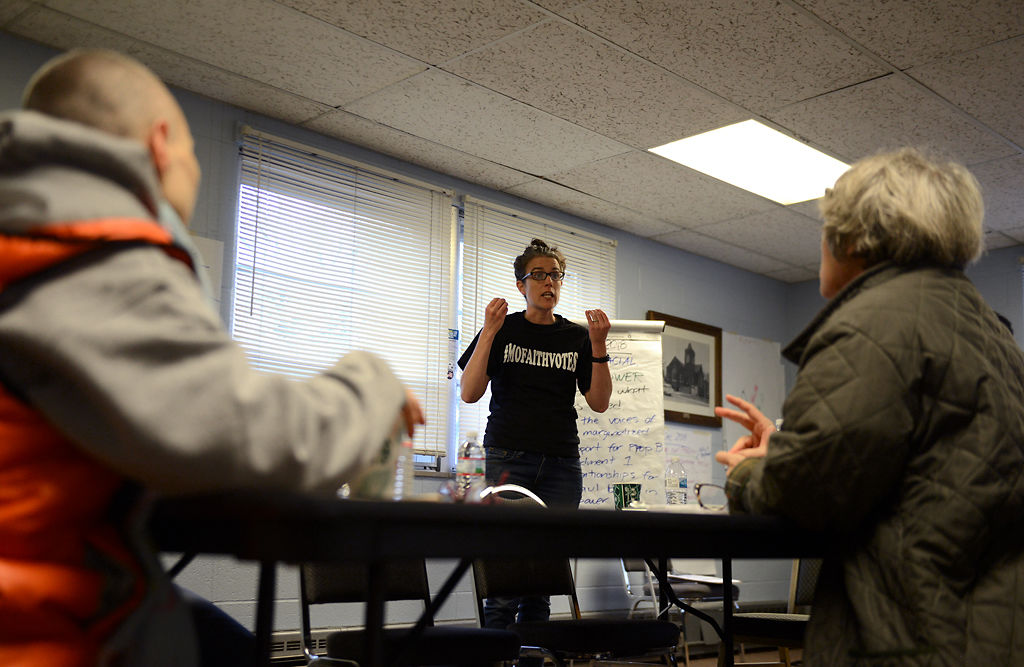 Columbia Faith Voices volunteers, listen to a training session