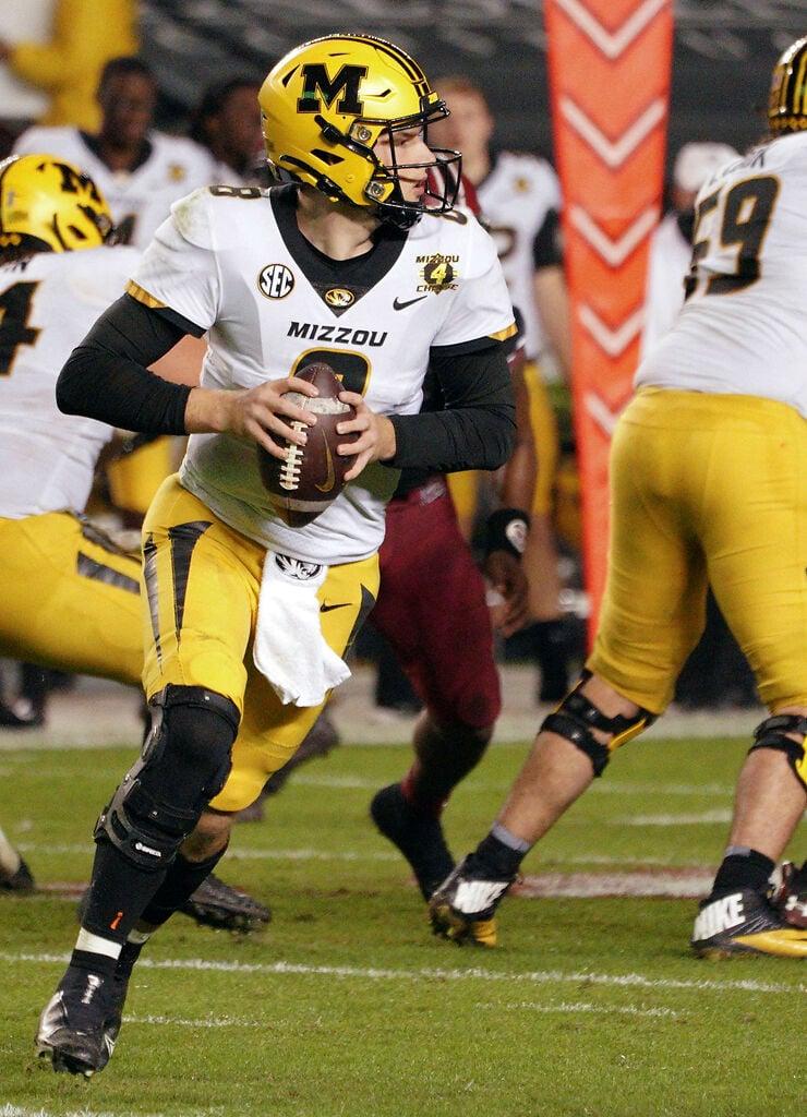 Connor Bazelak looks for an open receiver