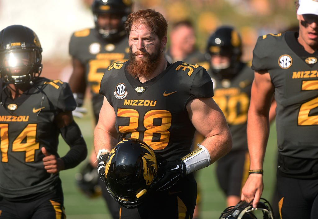 Missouri linebacker Eric Beisel leaves the field at halftime