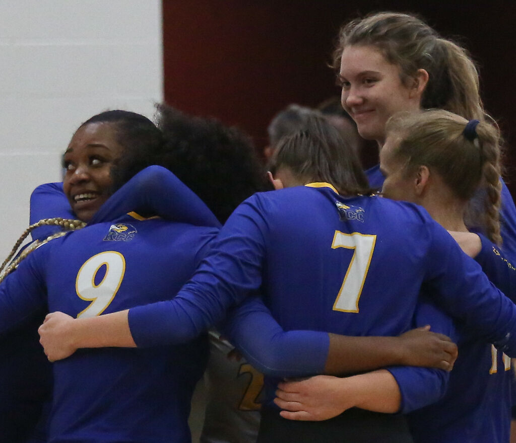 The Kansas Christian College volleyball team embraces