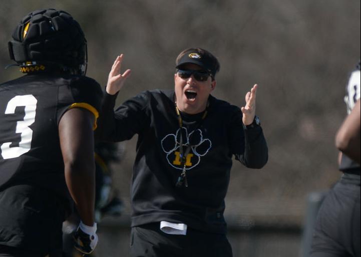 Missouri football head coach Eliah Drinkwitz motivates a player