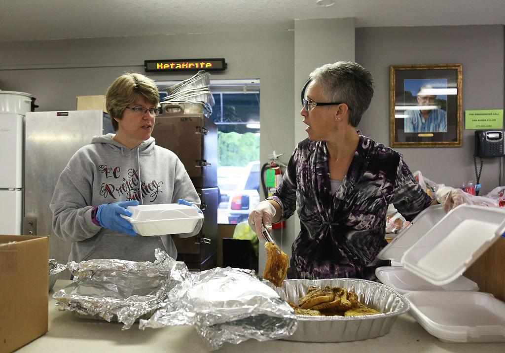 Missy Cox and Leslie Richardson pack food