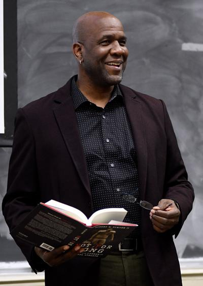 Robert W. Turner II finishes reading an excerpt from his book