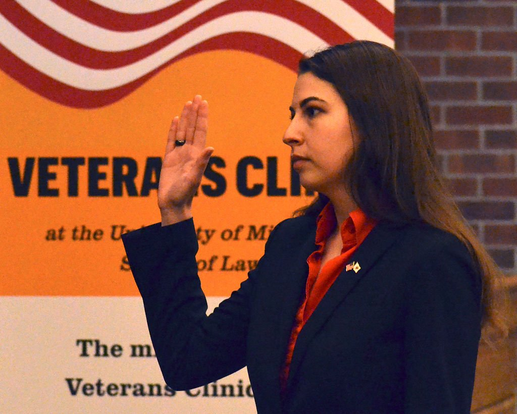 Larissa Tiller repeats an oath at her swearing ceremony