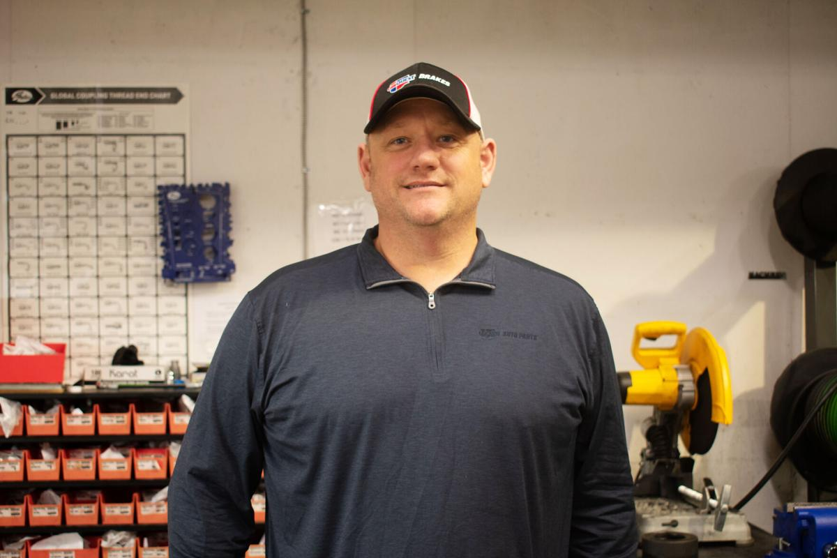 Donald Sanford stands near his workbench