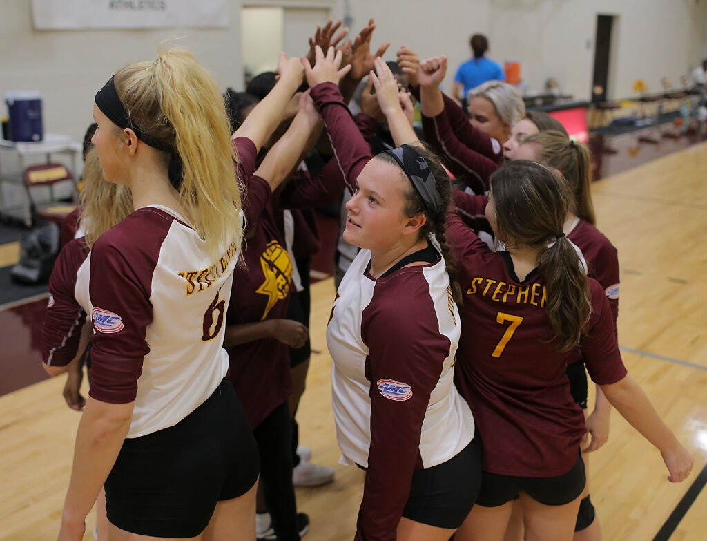 The Stephens College volleyball team end a huddle before the start of the third set of their game