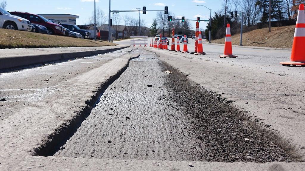 City workers repair pot holes on Forum Boulevard