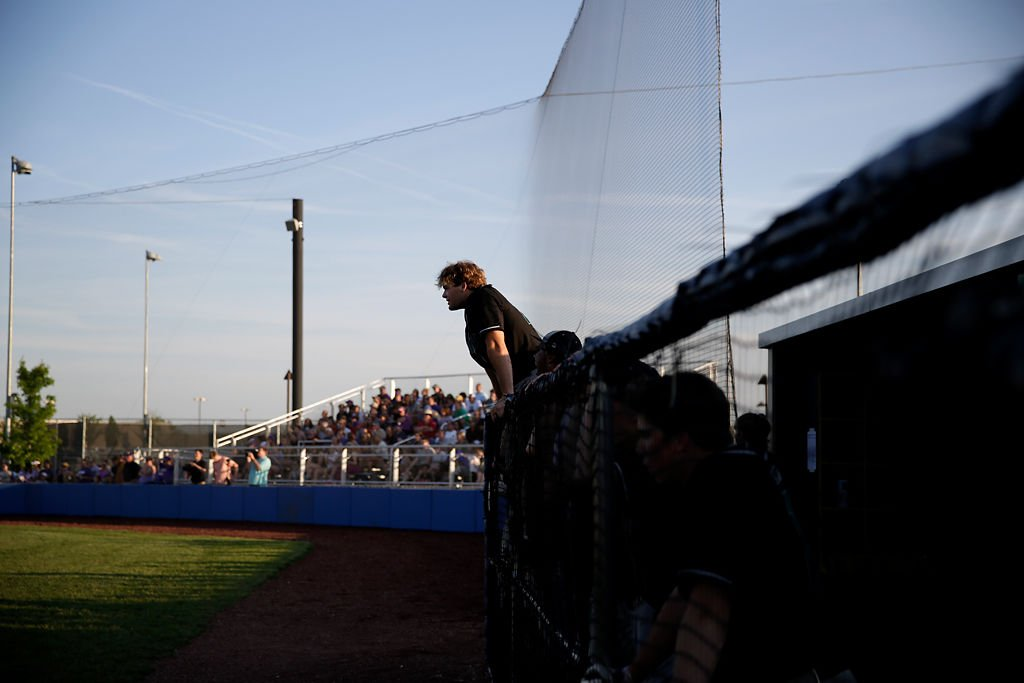 Junior Will Norris cheers on his teammate from the Rock Bridge dugout