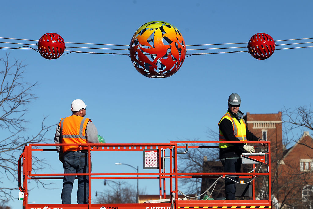 Grove Construction workers finish a light hub installation