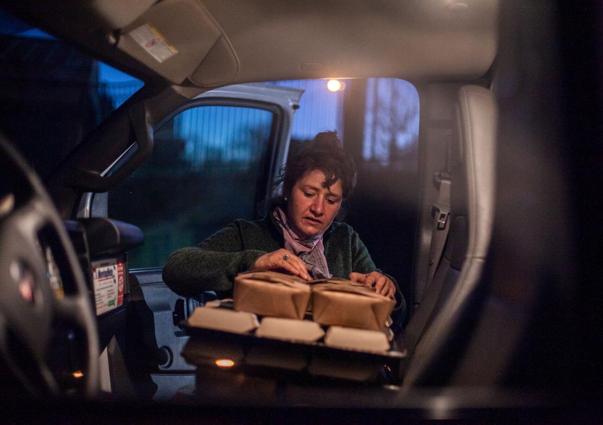 Michelle La Fata loads freshly made bucatini into the front seat of a U-Haul