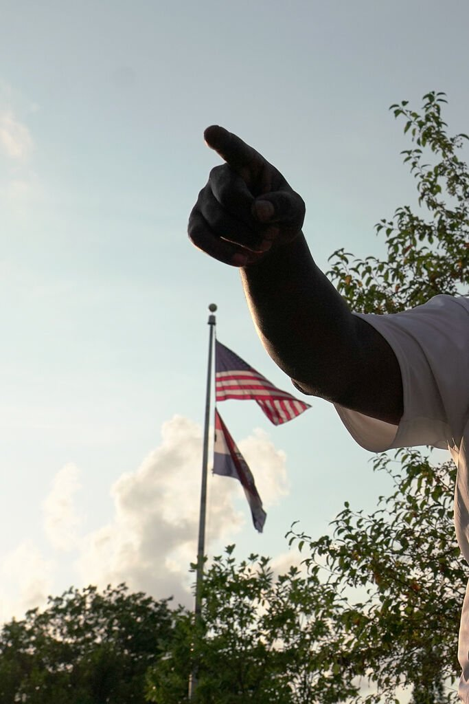 Sterling Brown points while making a speech at a protest for racial justice on Monday