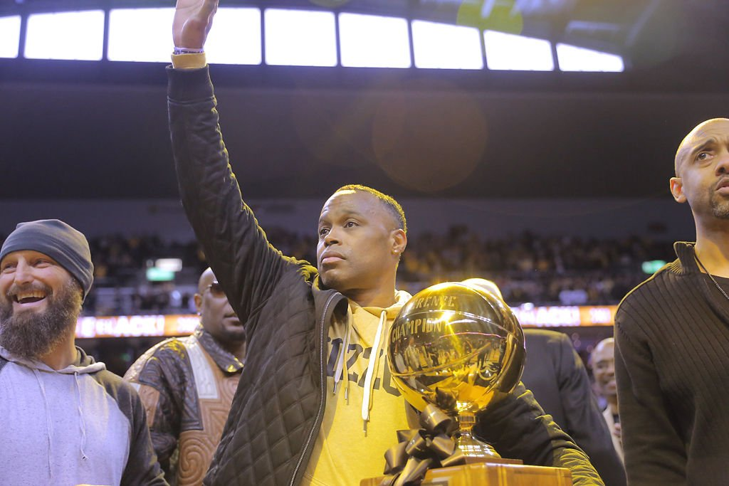 Melvin Booker salutes the crowd while holding the 1993-1994 Big Eight Conference trophy (copy)