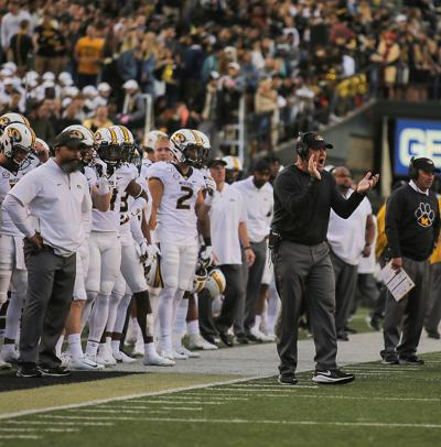 Missouri coach Barry Odom encourages his team