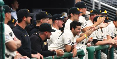 The Missouri baseball team celebrates a home run