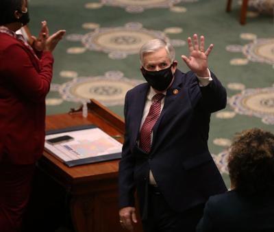 Gov. Mike Parson waves to members of the Missouri Senate